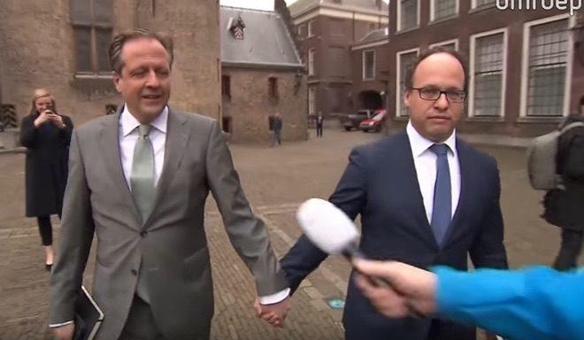 Dutch men hold hands against homophobia