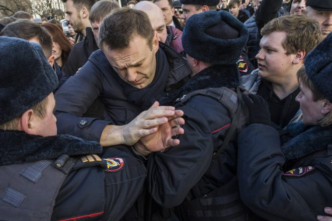 Navalny held after giant protests