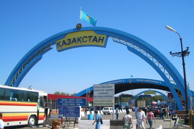 Kazakhstan's ethnic-Chinese minority return from Kyrgyzstan after coronavirus-sparked violence